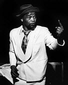 Winston Ntshona as Sizwe Banzi (R) in Sizwe Banzi Is Dead by Athol Fugard The Royal Court Theatre, London, 1973 - Chris Davies - 1970s,1973,ACE,act,acting,actor,actors,Arts,BAME,BAMEs,Black,BME,bmes,cities,city,Court,Culture,Dead,diversity,drama,DRAMATIC,ethnic,ethnicity,London,male,man,men,minorities,minority,people,person,per