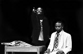 John Kani as Styles Buntu and Winston Ntshona as Sizwe Banzi (R) in Sizwe Banzi Is Dead by Athol Fugard The Royal Court Theatre, London, 1973 - Chris Davies - 1970s,1973,ACE,act,acting,actor,actors,Arts,back,BAME,BAMEs,Black,BME,bmes,cities,city,Court,Culture,Dead,diversity,drama,DRAMATIC,ethnic,ethnicity,John Kani,London,male,man,men,minorities,minority,pe