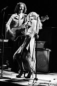 Hugh Fraser as Peyote on bass guitar and Helen Mirren singing as Maggie Frisby in Teeth 'N' Smiles, written and directed by David Hare, Royal Court Theatre, London, 1975 - Chris Davies - 02-09-1975