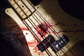 Bass guitar splattered in blood after a gig by heavy metal Doom band Conan, Leeds, Yorkshire - Connor Matheson - 2010s,2016,ACE,Arts,band,bands,blood,bloody,cities,City,concert,CONCERTS,Culture,gory,guitar,guitars,heavy,hygiene,injured,INJURIES,injury,Leeds,melody,metal,music,MUSICAL,musical instrument,musical i