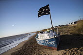 Boat resident staying put in Jaywick under severe flood warning from a storm surge. Essex - Jess Hurd - 13-01-2017