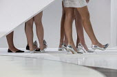 Detroit, Michigan, Models in short skirts and high heels wait backstage before unveiling Chinese GAC cars, North American International Auto Show - Jim West - 09-01-2017