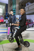 Detroit, Michigan, URB-E foldable electric vehicle, North American International Auto Show - Jim West - 2010s,2017,African American,African Americans,America,American,americans,auto show,automotive,Automotive Industry,BAME,BAMEs,black,BME,bmes,Car Industry,car show,carindustry,Detroit,display,displays,d
