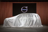 Detroit, Michigan, new model Volvo car under a sheet ready for unveiling , North American International Auto Show - Jim West - 2010s,2017,America,American,americans,anticipation,AUTO,auto industry,auto show,AUTOMOBILE,AUTOMOBILES,automotive,Automotive Industry,car,Car Industry,car show,carindustry,cars,covered,Detroit,display