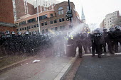 Riot police using CS gas. Anti Trump protests on Inauguration Day as Donald Trump takes office as President of USA, Washington DC - Jess Hurd - 20-01-2017