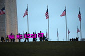 USA, Women's March on Washington DC. Over a million protest against Donald Trump on his first day as President. Protestors with narcissist placards by the Washington Monument - Jess Hurd - 21-01-2017