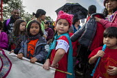 Oakland, California, USA, Womens March Against Trump. Filipino contingent organized by Filipino Advocates for Justice. Child wearing a label with her phone number in case they were separated from thei... - David Bacon - 21-01-2017