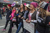 Oakland, California, USA, Women's March Against Trump - David Bacon - 2010s,2017,activist,activists,against,anti,Asian American,black,Black Lives Matter,California,CAMPAIGN,campaigner,campaigners,CAMPAIGNING,CAMPAIGNS,cities,City,DEMONSTRATING,demonstration,DEMONSTRATIO
