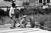 Children playing at the Talacre adventure playground in Kentish Town, London, 1971. in conditions on a derelict bomb site that would now be described as hazardous and a danger to health and safety - Chris Davies - 16-08-1971