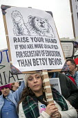 Washington DC USA, Women's March on Washington, a million protest against Donald Trump. Raise your hand if you are more qualified for secretary of education than Betsy Devos - Jim West - 21-01-2017
