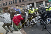 Washington DC, Police pepper spraying a Standing Rock protester during anti Trump protests on Inauguration Day as Donald Trump takes office as President of USA - Jess Hurd - assault,assaults,attack,attacks,bicycle,bicycles,cycling,cycle,cycles,BME,minority,ethnic,confrontation,confronting,cyclist,cyclists,Demonstration,helmet,helmets,Inauguration,Inauguration Day,Native A
