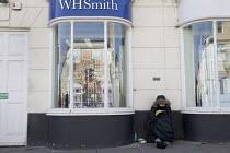 Homeless beggar, Stratford-upon-Avon, Warwickshire. Happy Valentines Day window display - John Harris - 04-02-2017