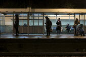 Passengers wait on Hampstead Heath Overground station platform after dark, London - Philip Wolmuth - 03-02-2017