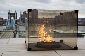 Cincinnati, Ohio: Freedom's Eternal Flame on a terrace outside the National Underground Railroad Freedom Center museum of the history of slavery and the underground railroad - Jim West - 17-01-2017