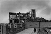 Factory being demolished Aston Birmingham 1987. Once a thriving industrial area male unemployment now risen to 43 - John Harris - ,1980s,1987,adult,adults,AGE,Ansells Brewery,Birmingham,capitalism,cities,city,deindustrialisation,Deindustrialization,demolish,DEMOLISHED,demolishing,demolition,developer,developers,DEVELOPMENT,DOWNT