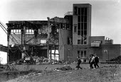 1987 Birmingham. Pupils passing a factory being demolished as they walk home from Secondary school, Aston once a thriving industrial area - John Harris - 26-03-1987