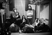 Members of the band McGuinness Flint, recording studio London 1972 (Tom McGuiness standing by door) - NLA - 1970s,1972,ACE,Arts,band,bands,cities,city,communicating,communication,conversation,conversations,Culture,dialogue,discourse,discuss,discusses,discussing,discussion,London,male,man,McGuinness Flin,mel