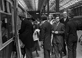 Norman Lamont (3rd R) boarding a train with other society figures for the wedding of Lady Fitzalan Howard, Victoria station, London 1975 - NLA - 1970s,1975,AFFLUENCE,AFFLUENT,boarding,Bourgeoisie,british,carriage,carriages,CONSERVATIVE,Conservative Party,conservatives,elite,elitism,high,high income,income,INEQUALITY,journey,JOURNEYS,Lady Fitza