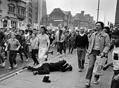 Police officer on the ground. Anti racist protest, Toxteth 1981, Liverpool, soon after Toxteth Riots. Injured Police officer on the pavement - NLA - 1980s,1981,activist,activists,adult,adults,against,Anti Racism,anti racist,CAMPAIGN,campaigner,campaigners,CAMPAIGNING,CAMPAIGNS,cities,City,CLJ,DEMONSTRATING,Demonstration,DEMONSTRATIONS,force,injure