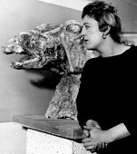 Sculptor Elisabeth Frink working on her sculpture Bird at her Fleming Close Studio London 1958. She used bird forms as metaphors for war and the pitiless destruction of man by man - Alan Vines - 1950s,1958,ACE,ACTING,Actor,actors,art,artist,artists,arts,artwork,artworks,bird,BIRDS,cities,city,creativity,culture,DESTROYED,destruction,Elisabeth Frink,FEMALE,Fine Art,form,forms,London,male,man,m