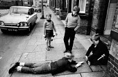 Boys playing a street game based on Rugy League sport, Wigan, Lancashire 1970 - Chris Davies - 1970,1970s,boy,boys,child,childhood,children,cities,City,ENJOYING,enjoyment,friend,friends,friendship,friendships,fun,game,games,inventive,juvenile,juveniles,kid,kids,leisure,LFL,LIFE,male,pavement,pe