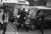 Brixton riots, London 1981. Police arresting a youth - Peter Arkell - 12-04-1981