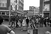 Brixton riots, London 1981. Youth stoning a police bus - Peter Arkell - 12-04-1981