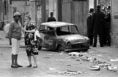 Brixton riots, London 1981, locals looking at the aftermath the day after - Peter Arkell - 12-04-1981