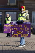 Supporters on the streets, Paul Nuttall UKIP By Election, Stoke on Trent Central, Staffordshire - John Harris - 2010s,2017,Brexit,by election,campaign,campaigning,CAMPAIGNS,cities,city,DEMOCRACY,election,elections,eurosceptic,Euroscepticism,eurosceptics,FEMALE,Paul Nuttall,people,person,persons,placard,placards