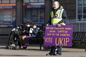 Supporters on the streets, Paul Nuttall UKIP By Election, Stoke on Trent Central, Staffordshire - John Harris - 2010s,2017,Brexit,by election,campaign,campaigning,CAMPAIGNS,cities,city,DEMOCRACY,election,elections,eurosceptic,Euroscepticism,eurosceptics,male,man,men,Paul Nuttall,pedestrian,pedestrians,people,pe