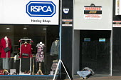 Homeless man in a shop doorway next to RSPCA charity shop, Stoke on Trent Central, Staffordshire - John Harris - 2010s,2017,apparel,asleep,charitable,charity,cities,city,clothes,clothing,doorway,excluded,exclusion,giving,HARDSHIP,help,helping,homeless,homelessness,impoverished,impoverishment,INEQUALITY,male,man,