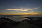 View from Mount Tampalpais as the sun sets on a calm sea north of San Francisco. The Farallones Islands are near the horizon - David Bacon - 2010s,2017,Bolinas,calm,CLOUD,clouds,coast,coastal,coasts,country,countryside,hill,hills,island,islands,landscape,landscapes,Mount Tampalpais,Mountain Range,mountainous,mountains,ocean,outdoors,outsid