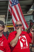 San Francisco, USA, workers at AT&T Mobility protest at the unwillingness of the company to agree a new union contract. Members of CWA in front of the AT&T Mobility office - David Bacon - 11-02-2017