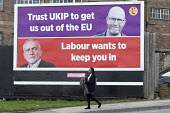 Black pupil walking past Vote Paul Nuttall UKIP board, Stoke on Trent Central, Hanley, Staffordshire, on the way home from school - John Harris - 2010s,2017,adolescence,adolescent,adolescents,advertisement,advertisements,advertising,BAME,BAMEs,billboard,billboards,Black,BME,bmes,Brexit,by election,campaign,campaigning,CAMPAIGNS,candidate,candid