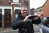 Christopher Furlong of Getty Images taking a photograph with a camera phone of Gareth Snell and Jeremy Corbyn MP, Labour Party canvassing, Cauldon, Stoke on Trent Central, Staffordshire - John Harris - 2010s,2017,by election,camera,camera phone,cameras,campaign,campaigning,CAMPAIGNS,candidate,candidates,CANVASING,canvassing,cities,City,communicating,communication,DEMOCRACY,election,elections,Housing