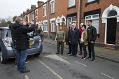 Christopher Furlong of Getty Images taking a photograph with a camera phone of Gareth Snell and Jeremy Corbyn MP, Labour Party canvassing, Cauldon, Stoke on Trent Central, Staffordshire - John Harris - 2010s,2017,by election,camera,camera phone,cameras,campaign,campaigning,CAMPAIGNS,candidate,candidates,CANVASING,canvassing,cities,City,communicating,communication,DEMOCRACY,election,elections,elector