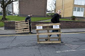 Youth carrying free pallets, Bentilee, Stoke on Trent, Staffordshire - John Harris - 17-02-2017
