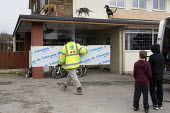 Dogs on the roof guarding a pub being refurbished, Bentilee, Stoke on Trent, Staffordshire - John Harris - 18-02-2017