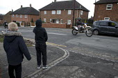 Boys watching speeding motorcycles, Bentilee, Stoke on Trent, Staffordshire - John Harris - 2010s,2017,anti social behavior,antisocial behaviour,behavior,behaviour,bike,boy,boys,building,buildings,child,CHILDHOOD,children,cities,City,CLJ,Crime,excluded,exclusion,HARDSHIP,highway,hobbies,hobb