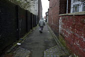 Elderly asian man walking down an alley, Hanley, Stoke on Trent, Staffordshire - John Harris - 2010s,2017,age,ageing population,alleyway,asian,building,buildings,cities,City,elderly,excluded,exclusion,HARDSHIP,house,houses,Housing Estate,impoverished,impoverishment,INEQUALITY,male,man,Marginali