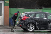 Car wash, Hanley, Stoke on Trent, Staffordshire - John Harris - 2010s,2017,AUTO,AUTOMOBILE,AUTOMOBILES,AUTOMOTIVE,by hand,car,Car wash,cars,cities,City,EARNINGS,eu,european,europeans,foreign,foreigner,foreigners,immigrant,immigrants,Income,inequality,living wage,L