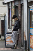 Youth using a mobile phone, Cauldon, Stoke on Trent, Staffordshire - John Harris - 18-02-2017