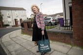 Women in the street with shopping, Dingle, Liverpool - Jess Hurd - 2010s,2016,age,ageing population,buying,cities,City,commodities,commodity,consumer,consumers,customer,customers,Dingle,elderly,FEMALE,Leisure,LFL,LIFE,Liverpool,old,pedestrian,pedestrians,people,perso