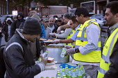 Homeless queuing for food handed out by the Imam Hasan Foodbank, Birmingham - Jess Hurd - 2010s,2016,Asian,Asians,assisting,BAME,BAMEs,Birmingham,Black,BME,bmes,bottle,bottles,charitable,charity,cities,City,curry,dining,dinner,dinners,distribution,diversity,ethnic,ethnicity,excluded,exclus