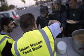 Homeless queuing for food handed out by the Imam Hasan Foodbank, Birmingham - Jess Hurd - 2010s,2016,Asian,Asians,assisting,BAME,BAMEs,Birmingham,Black,BME,bmes,charitable,charity,chicken,CHICKENS,cities,City,curry,dining,dinner,dinners,distribution,diversity,ethnic,ethnicity,excluded,excl