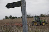 Farmer ploughing his land, Langley, Cambridgeshire. Footpath signpost - Jess Hurd - 07-10-2016