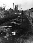 Trimdon Grange colliery and miners houses, County Durham, 1948 - Elisabeth Chat - 1940s,1948,capitalism,capitalist,Coal Industry,Coal Mine,coalindustry,collieries,colliery,EBF,Economic,Economy,excluded,exclusion,extracting,HARDSHIP,home,homes,house,houses,Housing,impoverished,impov