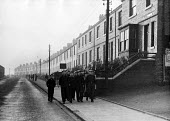 Miners known as Bevin Boys, walking through the Easington on their way to work at Easington Colliery, County Durham, 1948 - Elisabeth Chat - 1940s,1948,Bevin Boys,BOY,Boys,capitalism,capitalist,child,CHILDHOOD,children,Coal Industry,Coal Mine,coalindustry,collieries,colliery,communities,community,conscript,conscripted,conscription,conscrip