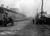 Miners known as Bevin Boys, walking through Easington on their way to work, Easington Colliery, County Durham, 1948. 9.30 in the morning - Elisabeth Chat - 1940s,1948,animal,animals,BOY,Boys,capitalism,capitalist,child,CHILDHOOD,children,Coal Industry,Coal Mine,coalindustry,collieries,colliery,conscript,conscripted,conscription,conscripts,deliveries,deli