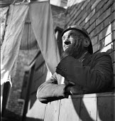 Miner at the end of his shift, Horden Colliery, County Durham, 1948 washing hanging to dry in the back yard - Elisabeth Chat - 01-06-1948
